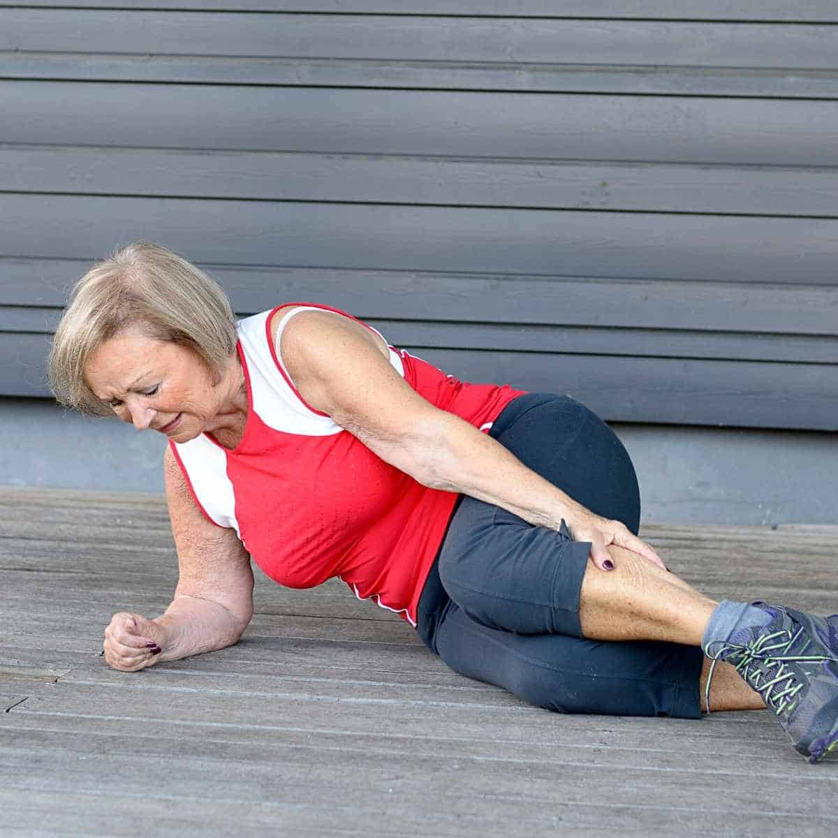 old lady with sore muscles - How to Fix Whole Body Aches on Keto: Advice from a Nutritionist
