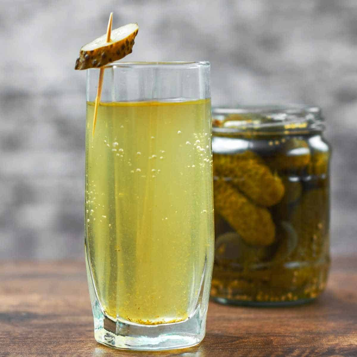 glass of pickle juice - How to Fix Whole Body Aches on Keto: Advice from a Nutritionist