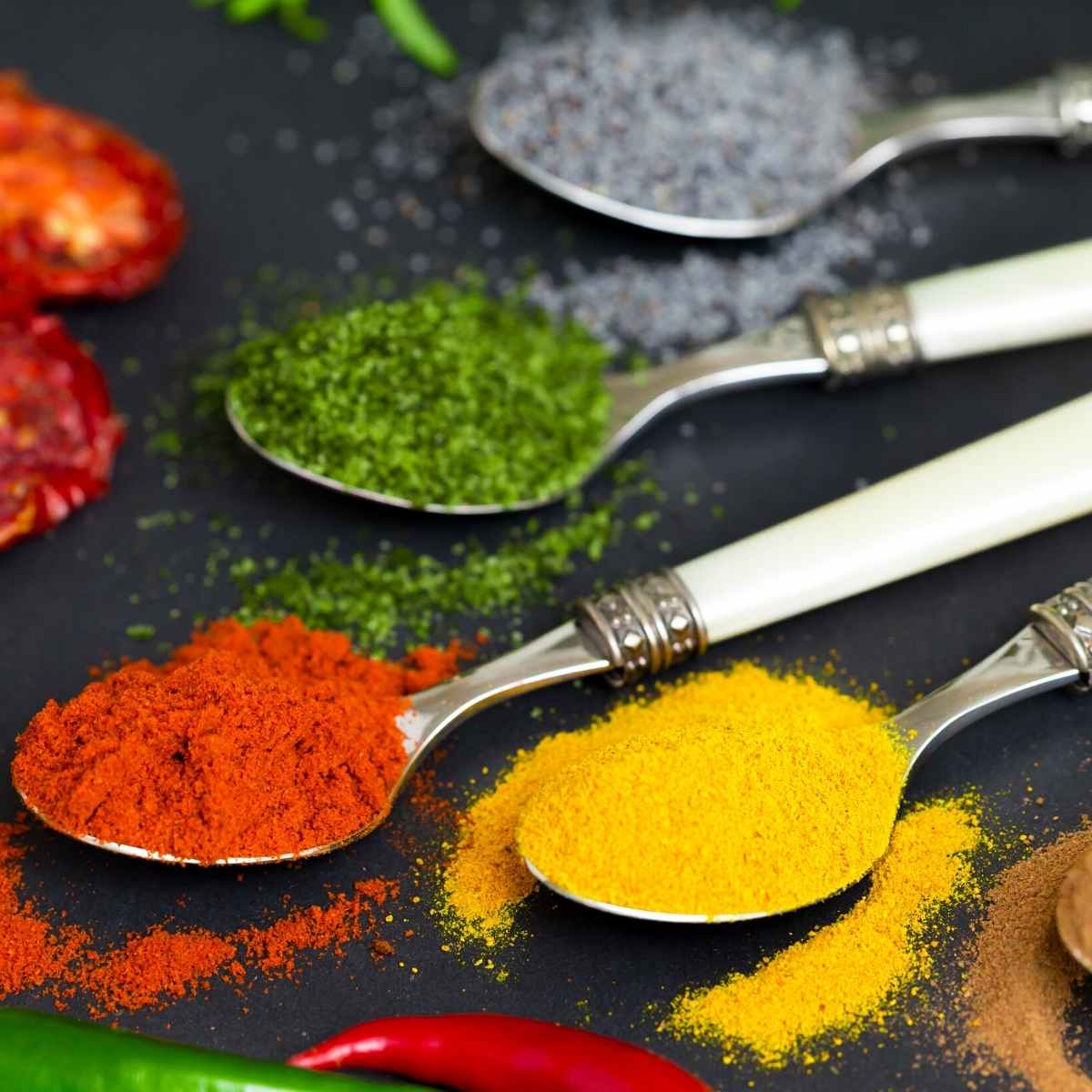 spoons filled with spices - 36 Herbs And Spices That Are Keto Friendly